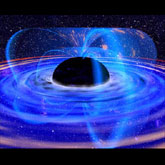 Artists conception of matter swirling around a black hole, both in the accretion disk and captured by the magnetic field.