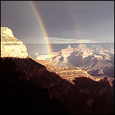 Double rainbow, note the color reversal in the faint, secondary rainbow.