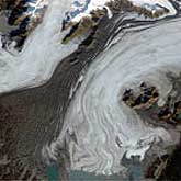 The image of the Bering Glacier were taken in October 1986 and September 2002 derived from the Landsat 5 and Landsat 7 satellites, respectively.