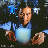 Scientist Peter Tsou holding a cube of Solid Smoke aerogel.
