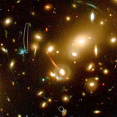 This new galaxy was detected in a long exposure of the nearby cluster of galaxies Abell 2218, taken with the Advanced Camera for Surveys on board the Hubble Space Telescope.