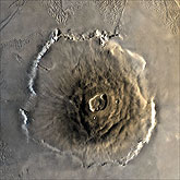 The largest known volcano in the solar system, Olympus Mons.